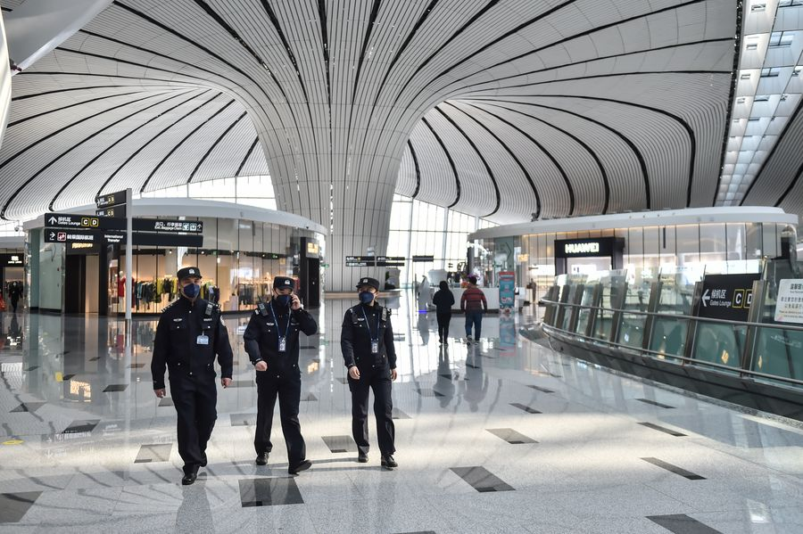Policeman Wu Shengzao (1st L) patrols with his colleagues at the Daxing International Airport in Beijing, capital of China, Feb. 1, 2020. (Photo by Peng Ziyang/Xinhua)