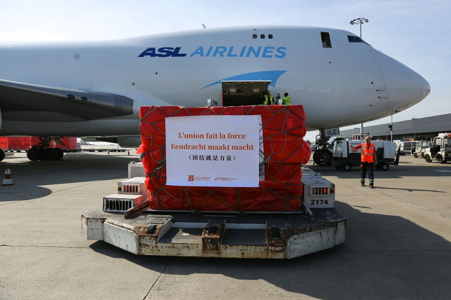 Chinese medical supplies for Belgium are unloaded at the Liege Airport in Liege, Belgium, on March 16, 2020. (Xinhua/Zhang Cheng)