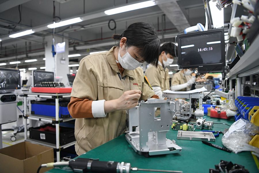 Employees produce ventilators at Mindray Bio-Medical Electronics Co., Ltd., a medical device manufacturer based in Shenzhen, south China