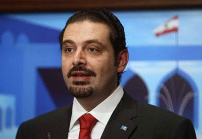 Lebanon's Prime Minister-designate Saad al-Hariri speaks after announcing the new cabinet at the presidential palace in Baabda, near Beirut, November 9, 2009.(Xinhua/Reuters Photo)