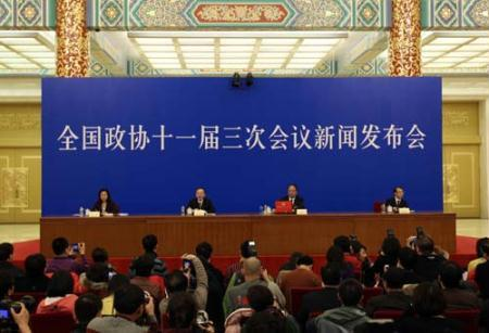 Zhao Qizheng (2nd, R), spokesman of the Third Session of the 11th Chinese People's Political Consultative Conference (CPPCC) National Committee, speaks during a news conference on the CPPCC session at the Great Hall of the People in Beijing, capital of China, March 2, 2010. (Xinhua/Ding Lin)