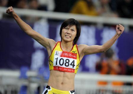 WangJingofFujianProvincecelebratesafterwinningthefinalofwomen's100msprintatthe11thChineseNationalGamesinJinan,eastChina'sShandongProvince,October22,2009.[Filephoto:Xinhua]