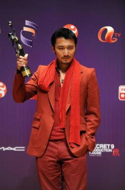 "Hong Kong actor Nicholas Tse poses with his trophy at the backstage after winning the Best Supporting Actor for his role in the movie ""Bodyguards and Assassins"" at the 29th Hong Kong Film Awards held in Hong Kong, south China, April 18, 2010. (Xinhua Photo)"