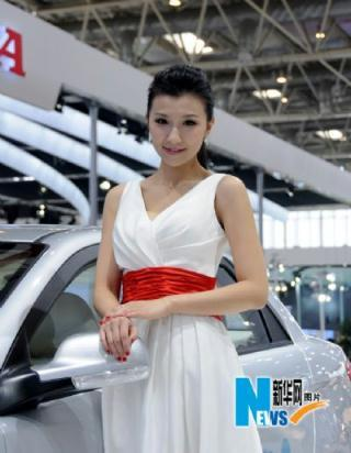A model poses at 2010 Beijing International Automotive Exhibition on April 23, 2010. The auto exhibition kicked off Wednesday at China International Exhibition Center in Beijing. (Xinhuanet Photo