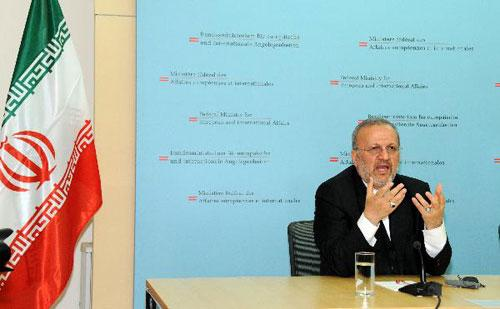 Iranian Foreign Minister Manouchehr Mottaki speaks during a joint press conference with his Austrian counterpart Michael Spindelegger (not pictured) in Vienna April 25, 2010. (Xinhua/Liu Gang)