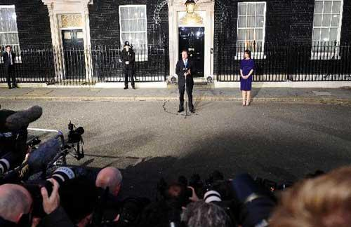 Britain's new Prime Minister Conservative party leader David Cameron speaks in front of 10 Downing Street in London, on May 11, 2010. Cameron was appointed by Britain's Queen Elizabeth II as new prime minister. (Xinhua/Zeng Yi)