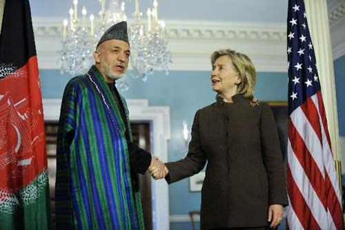 U.S. Secretary of State Hillary Clinton (R) and visiting Afghan President Hamid Karzai meet journalists before their bilateral meeting at the State Department in Washington D.C., capital of the United States, May 11, 2010. (Xinhua/Zhang Jun)