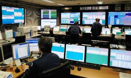 The staff members of the Japan Meteorological Agency (JMA) monitor earthquakes in Tokyo, the capital of Japan, on May 11, 2010. The Japan Meteorological Agency (JMA) provides residents in Japan with earthquake early warnings. The Earthquake Early Warning system issues prompt alerts just as an earthquake starts, providing valuable seconds for people to protect themselves before strong tremors arrive. The system announces the estimated seismic intensities and expected arrival time of principal motion. These estimations are based on prompt analysis of the focus and magnitude of the earthquake using wave form data observed by seismographs near the epicenter. (Xinhua/Ji Chunpeng)