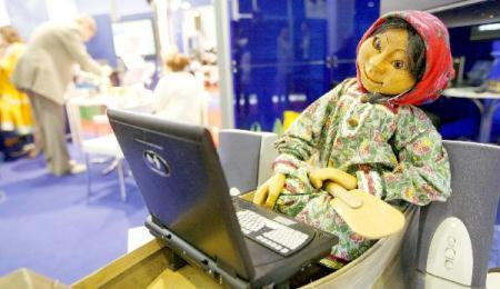 A doll is made to use a laptop during the 22nd International Exhibition for Telecommunications, Control System, and Communication services in Moscow, capital of Russia, May 11, 2010. The 4-day-long exhibition opened here on Tuesday.  (Xinhua/Lu Jinbo)