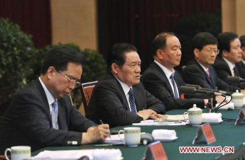 Zhou Yongkang, a member of the Standing Committee of the Political Bureau of the Central Committee of the Communist Party of China, speaks during a two-day meeting on the country's social security management that ended Saturday in Chengdu, southwest China's Sichuan Province.(Xinhua/Huang Jingwen)