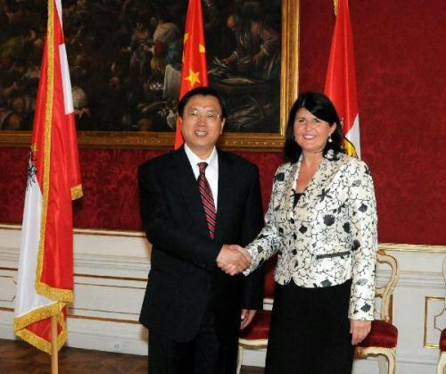 Visiting Chinese Vice Premier Zhang Dejiang (L) meets with governor of the Austrian state of Salzburg Gabi Burgstaller in Salzburg, Austria, June 21, 2010.(Xinhua/Liu Gang)