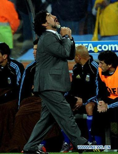 Argentina's coach Diego Maradona celebrates after winning the 1/8 final match against Mexico at the 2010 FIFA World Cup at Soccer City stadium in Johannesburg, South Africa, on June 27, 2010. Argentina won 3-1. (Xinhua/Wang Yuguo)