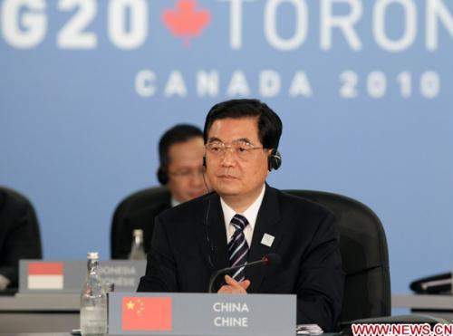 Chinese President Hu Jintao attends a plenary session of the fourth summit of the Group of 20 (G20), in Toronto, Canada, June 27, 2010.(Xinhua/Fan Rujun)