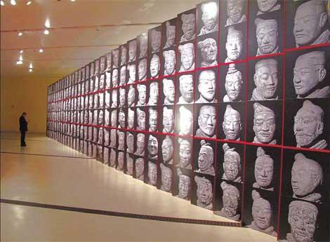 More than 192 faces of terracotta warriors are pictured at the entrance to the Warrior Emperor and China's Terracotta Army exhibition. (Photo: China Daily)