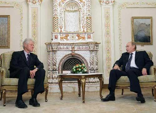 Russian Prime Minister Vladimir Putin, right, and former U.S. President Bill Clinton seen during their meeting in the Novo-Ogaryovo residence outside Moscow, Russia, Tuesday, June 29, 2010. (Xinhua/Reuters Photo)