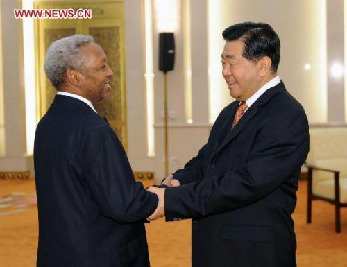 Jia Qinglin(R), chairman of the National Committee of the Chinese People's Political Consultative Conference(CPPCC), meets with Idriss Arnaoud Ali, secretary-general of the People's Rally for Progress (PRP) of Djibouti, in Beijing, July 1, 2010.(Xinhua/Li Tao)