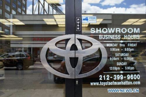 The Toyota logo is seen on the door at a dealership in New York, the United States, July 1, 2010. Toyota Motor Corp. said Thursday about 270,000 cars sold worldwide, including luxury Lexus and Crown sedens, have potentially faulty engines, in the latest quality issue to confront the Japanese automaker after a string of massive recalls.(Xinhua/Wu Kaixiang)