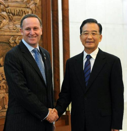 Chinese Premier Wen Jiabao (R) meets with New Zealand's Prime Minister John Key at the Great Hall of the People in Beijing, capital of China, on July 7, 2010.(Xinhua/Rao Aimin)