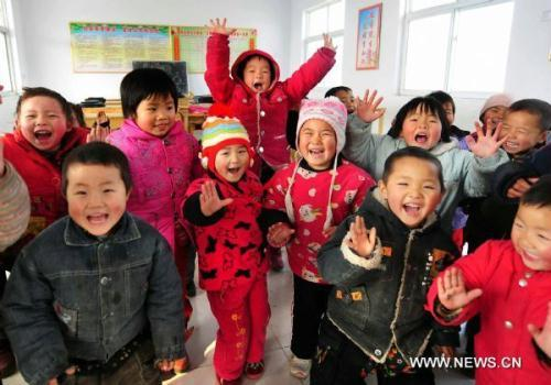 File photo taken on Dec. 23, 2009 shows children play at a kindergarten in Baofeng County, central China's Henan Province. The population of Henan Province is estimated to reach 100 million in July, 2010, according to the provincial committee of population and family planning.(Xinhua/Wang Song)