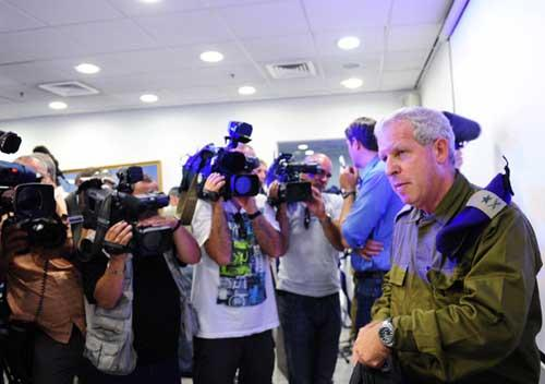 Former Israeli general Giora Eiland (R Front), who heads Israeli army's internal investigation panel, prepares to leave after a news conference in Tel Aviv, on July 12, 2010. (Xinhua/Yin Dongxun)
