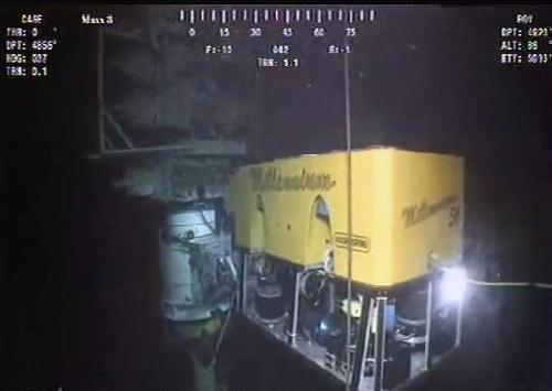 This still image from a live BP video feed shows robots installing the sealing cap over a gushing well in the Gulf of Mexico. BP successfully placed a new cap over the Gulf of Mexico oil leak, hoping the giant valve will seal the well or contain all the gushing crude, underwater video footage showed.(Xinhua/AFP Photo)