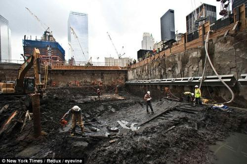 Ship-shape: Archaeologists work on the remains of an 18th century ship found buried at the site of the World Trade Centre yesterday.