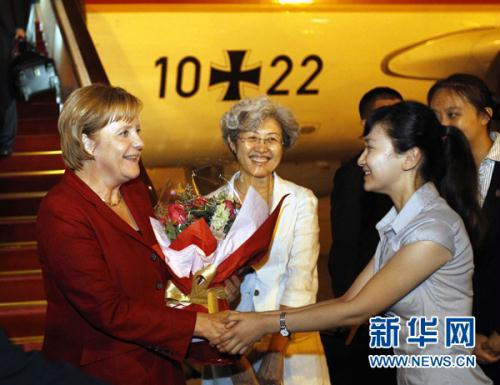 Photo: German Chancellor Angela Merkel(L) arrived in Beijing Thursday night, starting a four-day official visit to China. This is her 4th time China visit since she took office.(Xinhua)