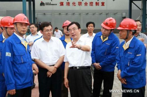 He Guoqiang, member of the Standing Committee of the Political Bureau of the Communist Party of China (CPC) Central Committee, visits a coal liquefaction factory in the Inner Mongolia Autonomous Region, July 16, 2010. He Guoqiang paid an inspection to Inner Mongolia from July 15 to July 18.(Xinhua/Pang Xinglei)