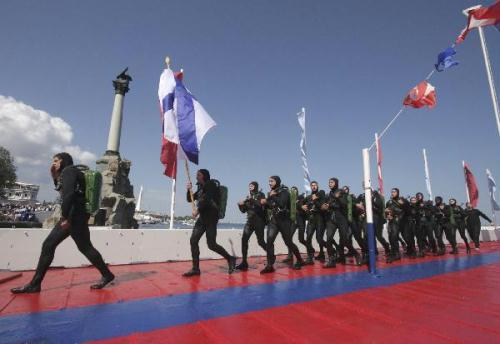 Russian seamen march during a parade celebrating Navy Day at the harbour of the Ukrainian Black Sea port of Sevastopol July 25, 2010. Russia marks its Navy Day on Sunday. (Xinhua/Reuters Photo)