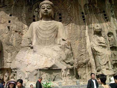 Chinese tourists visit Buddhist statues at the Longmen Grottoes, a world cultural heritage, near Luoyang City in central China's Henan Province, May 2, 2009, the second day of the three-day May Day holiday. China has a totality of 37 world heritages which attract many tourists in the holiday. (Xinhua/Cheng Qianjun)