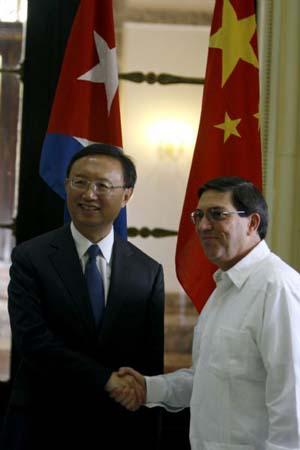 Visiting Chinese Foreign Minister Yang Jiechi (L) shakes hands with his Cuban counterpart Bruno Rodriguez during their meeting on the development of relations between their two countries in Havana of Cuba July 31, 2010. (Xinhua/Wang Pei)