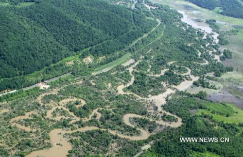 The aerial photo taken on July 30, 2010 shows the flood-battered area in Antu County of Yanbian Korean Autonomous Prefecture, northeast China's Jilin Province. (Xinhua/Jiang Hechun)