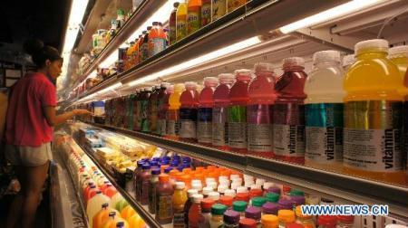 "Bottles of Coca-Cola's Vitamin water are sold in a store in New York, the United States, Aug. 4, 2010. Judge John Gleeson of the U.S. District Court in Brooklyn said the health claims on some Vitamin water bottles may be in violation of FDA regulations since the drink ""achieves its nutritional content solely through fortification that violates FDA policy"", Time Magazine reported. Gleeson also ruled that the claim that the Vitamin water name misleads consumers is potentially actionable, since that key third ingredient, sugar, is conveniently absent from the title, the report said. (Xinhua/Wu Kaixiang)"