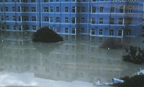 Screen grab taken on Aug. 8, 2010 shows the flooded city zone of Zhouqu County, Gannan Tibetan Autonomous Prefecture in northwest China's Gansu Province. At least 65 people have been killed and hundreds of people are missing as of Sunday morning in rainstorm-triggered landslides which hit Zhouqu County.(Xinhua)
