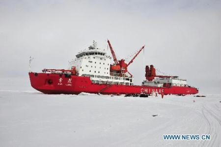 "Photo taken on Aug. 8, 2010 shows China's icebreaker ""Xue Long"", or ""Snow Dragon"", at 86 degrees and 55 minutes north latitude, 178 degrees and 53 minutes west longitude, where the Chinese expedition team to the Arctic has built a fixed ice station for a 15-day scientific survey on the Arctic Ocean.(Xinhua/Zhang Jiansong)"