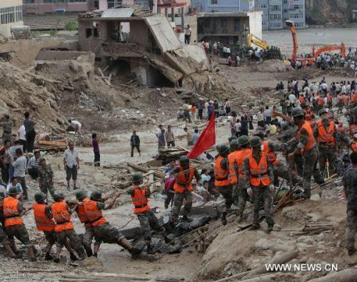Rescuers work in the landslide-hit Zhouqu County, Gannan Tibetan Autonomous Prefecture in northwest China's Gansu Province, Aug. 9, 2010. The death toll from rain-triggered mudslides in Zhouqu County has risen to 337, with 1,148 others still missing, official sources said Monday night. Rescuers are racing against time in search for survivors in the mudslide-flattened Zhouqu. (Xinhua/Xing Guangli)