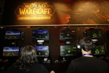 Visitors play 'World of Warcraft' at their exhibition stand at the Gamescom 2010 fair in Cologne August 18, 2010. The Gamescom convention, Europe's largest video games trade fair, runs from August 18 to August 22. (Xinhua/Reuters)