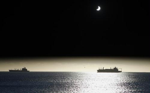 The moon passes between the sun and the earth during a solar eclipse in Valparaiso City, 75 miles (121 km) northwest of Santiago, July 11, 2010.  (Xinhua/Reuters File Photo)