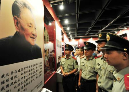 Frontier soldiers visit an exhibition commemorating the late Chinese leader Deng Xiaoping, known as the paramount leader of China's reform and opening-up in Shenzhen, the country's first special economic zone in South China's Guangdong province August 22, 2010. Sunday marks the 106 anniversary of Deng and the city will celebrate the 30th anniversary of the establishment of the Shenzhen Special Economic Zone, the brainchild of Deng, on August 25. [Photo/Xinhua]