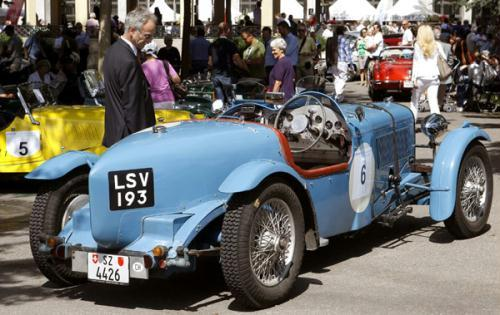 A man looks at an 1934 Alvis Speed 20 car during a prologue of the Raid-Suisse-Paris 2010 vintage car rally in Zurich August 25, 2010. The three-day Raid-Suisse-Paris 2010 starts in Basel on Thursday.(Xinhua/Reuters Photo)