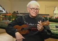 Buffett sings and plays guitar