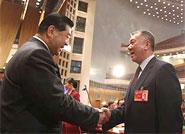 贾庆林祝贺何厚铧当选政协副主席