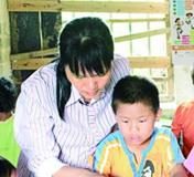 广西北流市六麻镇上合小学水表分校教师黄业珍