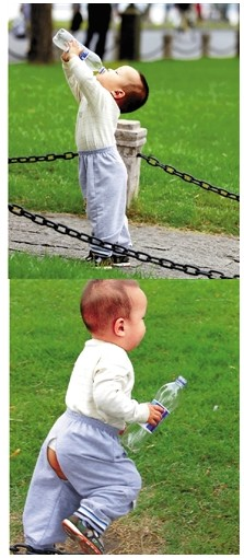 两岁孩子为将饮料瓶扔入垃圾桶摔跤感动众人(图)