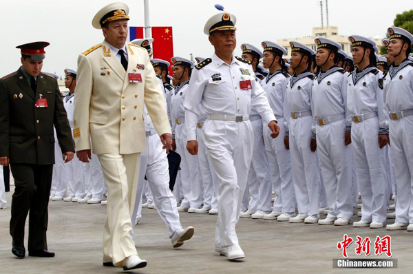 "Chinese and Russian military forces have gathered in Shanghai ahead of a ""Naval Interaction"" drill in the East China Sea."