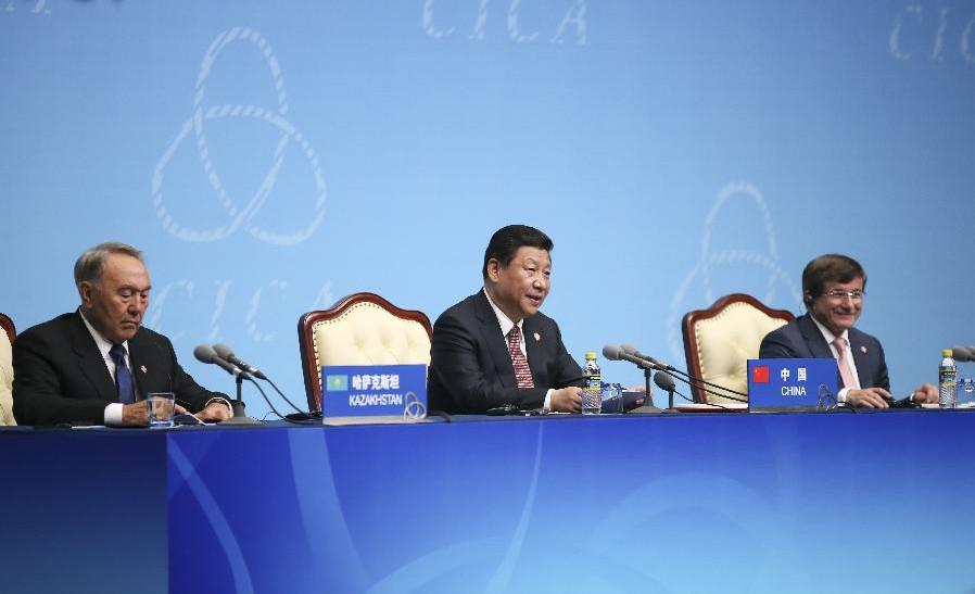 Chinese President Xi Jinping (C), Kazakhstan