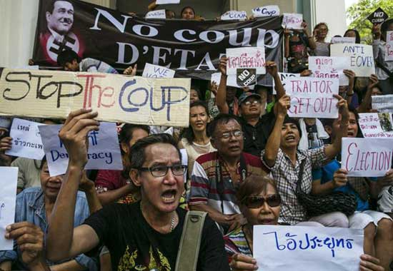 Thai protesters chant anti- coup slogans during an anti-coup protest on the third day of the military coup May 25, 2014 in Bangkok, Thailand.
