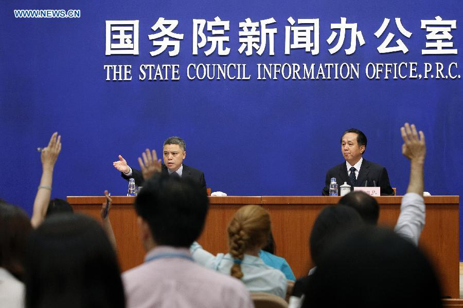 Li Minghua (R), deputy director of the State Archives Administration of China, attends a presss conference in Beijing, capital of China, July 3, 2014. Confessions made by 45 Japanese war criminals tried and convicted by military tribunals in China after World War II (WWII) will be published on the website of the Chinese State Archives Administration from Thursday, which is http://61.135.203.68/rbzf. Handwritten confessions, along with Chinese translations and abstracts in both Chinese and English, will be published by one each day over a 45-day period. (Xinhua/Shen Bohan)