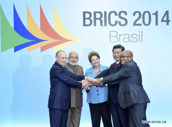 Chinese President Xi Jinping (2nd R) poses for a group photo with Russian President Vladimir Putin (1st L), Indian Prime Minister Narendra Modi (2nd L), Brazilian President Dilma Rousseff (C), and South African President Jacob Zuma during the sixth BRICS summit in Fortaleza, Brazil, July 15, 2014. (Xinhua/Li Xueren)
