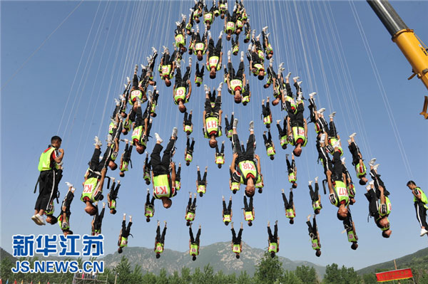 Performers are training day and night for their big moment at the opening ceremony of the Youth Olympic Games to be held in Nanjing in mid August.